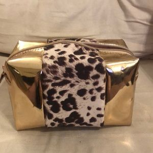 Rose gold and leopard makeup bag